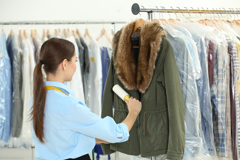Dry cleaners washing a coat